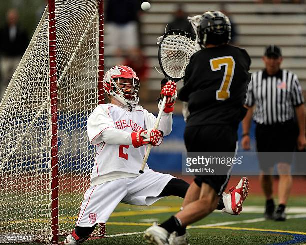 Arapahoe High School senior attacker Tyler Widlund scores a goal against Regis Jesuit sophomore goalie Bret Quartuccio during a CHSAA 5A boys...
