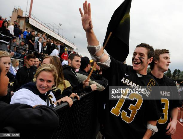 Arapahoe High School senior midfielder Kiely O'Connor waves to the crowd after his team defeated Regis Jesuit during a semifinals CHSAA 5A boys...