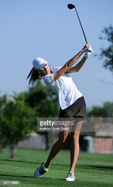 Arapahoe's Katy Dyachkova drives off the first tee in round 1of the 2012 Girls' Golf CHSAA 5A State Championships at Aurora Hills Golf Course on...