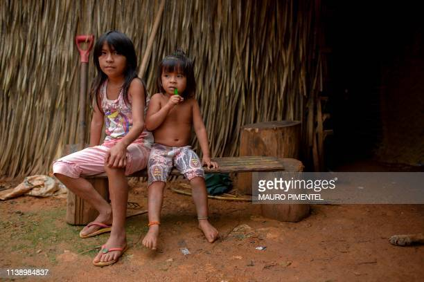 Arara indigenous children remain outside an Arara traditional house at the Arado tribal camp in Arara indigenous land located beside the...