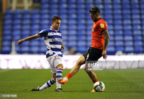 Araruna of Reading FC passes the ball past George Moncur of Luton Town during Carabao Cup Second Round match between Reading FC and Luton Town at...