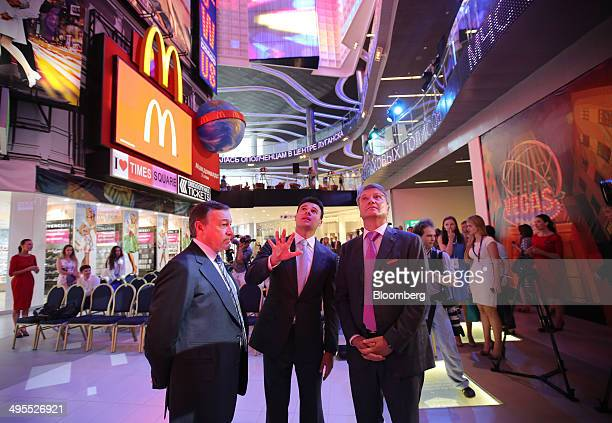 Aras Agalarov founder of Crocus Group left Herman Gref chief executive officer of OAO Sberbank right and Emin Agalarov commercial director of Crocus...