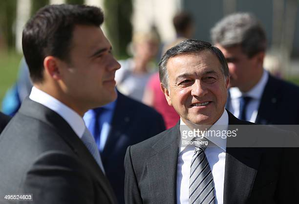 Aras Agalarov founder of Crocus Group right and his son Emin Agalarov commercial director of Crocus Group wait ahead of the opening ceremony for...