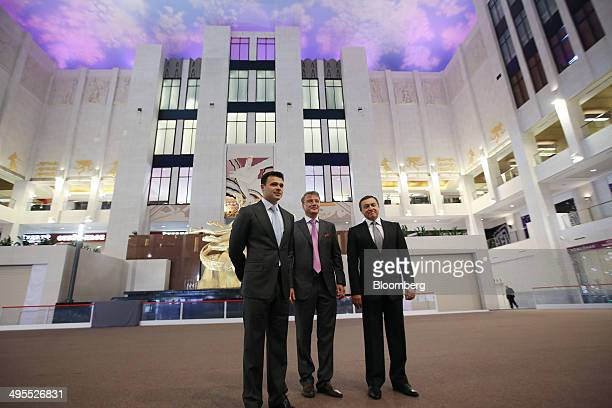 Aras Agalarov founder of Crocus Group right Herman Gref chief executive officer of OAO Sberbank center and Emin Agalarov commercial director of...