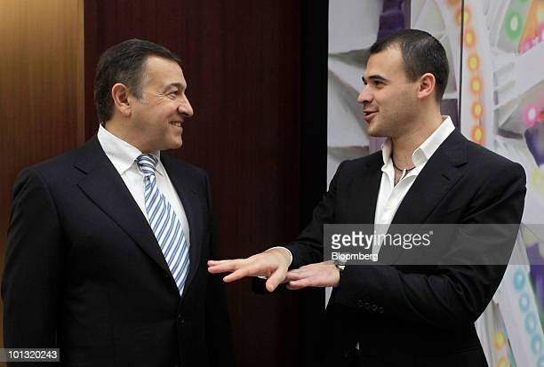 Aras Agalarov owner of Crocus Group left speaks with his son Emin Agalarov coowner of Vegas mall prior to the opening of the shopping mall in Moscow...