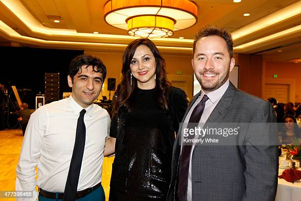 Arash Ferdowsi Bita Daryabari and and Drew Houston pose for a photograph at the PARS Equality Center 4th Annual Nowruz Gala at Marriott Waterfront...