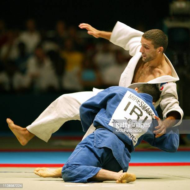 Arash Miresmaili of Iran pushes down French Larbi Benboudaoud during the men's under 66 kg class final match at the World Judo Championships in Osaka...
