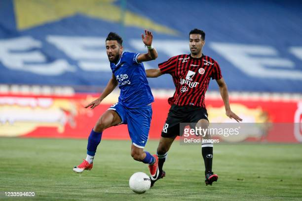 Arash Rezavand of Esteghlal and Mohammadreza Falahian of Padideh battle for the ball during the Persian Gulf Pro League match between Esteghlal and...