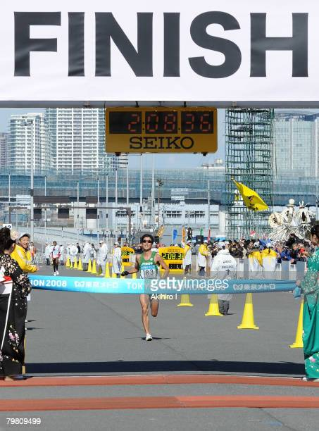 Arata Fujiwara of Japan approaches the finish line in second place during the 2008 Tokyo Marathon at Tokyo Big Sight on February 17 2008 in Tokyo...