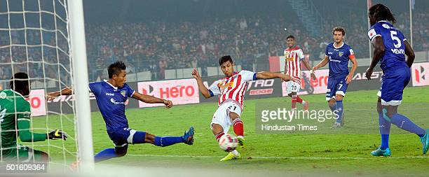 Arata Izumi of Atletico de Kolkata vying for the ball with Chennaiyin FC players during their ISL semifinal second leg match at Yuva Bharati...