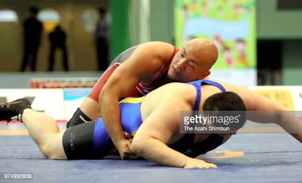 Arata Sonoda and Masahiro Tanida compete in the Men's GrecoRoman 130kg final on day one of the All Japan Wrestling Invitational Championships at...