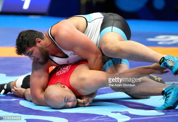Arata Sonoda of Japan and Abdellatif mohamed ahmed Mohamed of Egypt compete in the Men's 130kg first round on day three of the World Wrestling...