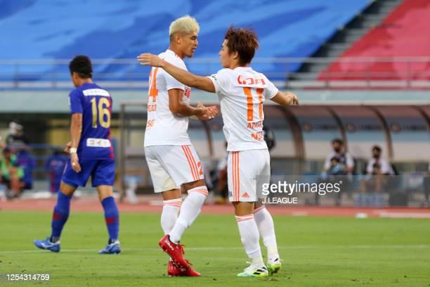 Arata Watanabe of Albirex Niigata celebrates scoring his side's first goal with his team mate Frank Romero during the J.League Meiji Yasuda J2 match...
