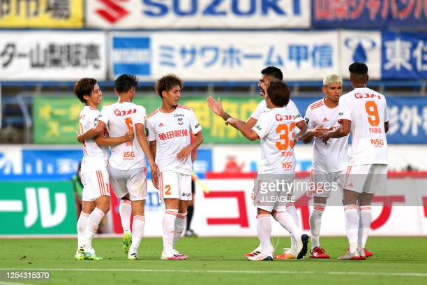 Arata Watanabe of Albirex Niigata celebrates scoring his side's second goal with his team mates during the J.League Meiji Yasuda J2 match between...