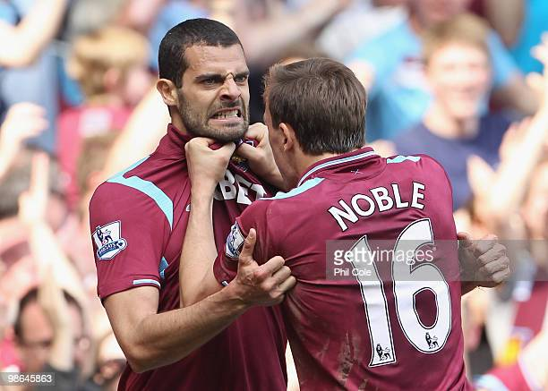 Araujo Ilan of West Ham celebrates with Mark Noble after scoring during the Barclays Premier League match between West Ham United and Wigan Athletic...