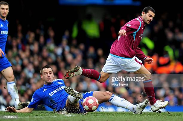 Araujo Ilan of West Ham is tackled by John Terry of Chelsea during the Barclays Premier League match between Chelsea and West Ham United at Stamford...