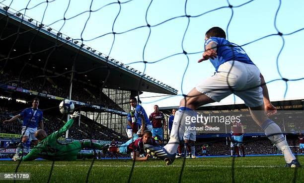 Araujo Ilan of West Ham United scores his team's second goal past Tim Howard of Everton during the Barclays Premier League match between Everton and...