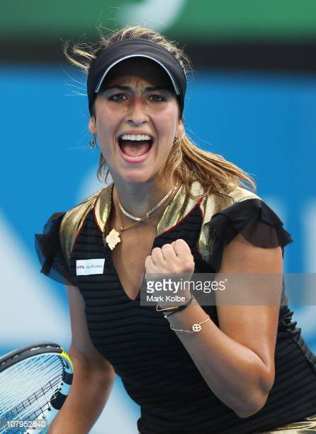 Aravane Rezai of France celebrates winning a point in match against Jelena Jankovic of Serbia during day two of the 2011 Medibank International at...