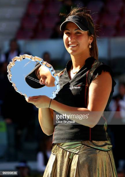Aravane Rezai of France holds aloft the winners torphy after her straight sets victory against Venus Williams of the USA in the womens final match...