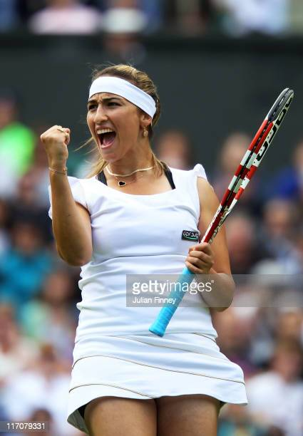 Aravane Rezai of France reacts to a play during her first round match against Serena Williams of the United States on Day Two of the Wimbledon Lawn...