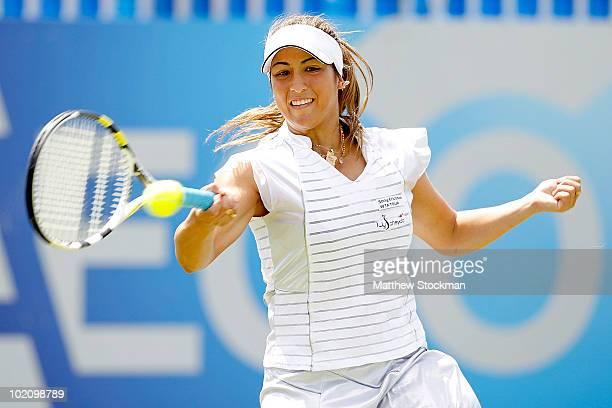 Aravane Rezai of France returns a shot to Caroline Wozniacki of Denmark during the AEGON International at Devonshire Park on June 15 2010 in...