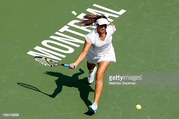 Aravane Rezai of France returns a shot to Petra Kvitova of the Czech Republic during the Rogers Cup at Stade Uniprix on August 16 2010 in Montreal...