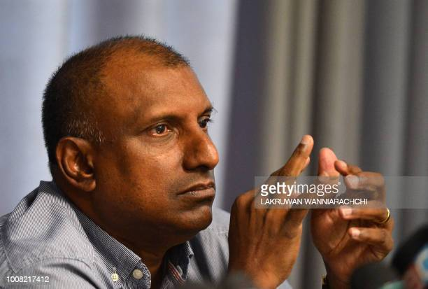 Aravinda de Silva Deputy of Sri Lanka's World Cup winning skipper and Ministry of Petroleum Resources Development Arjuna Ranatunga looks on during a...