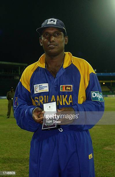 Aravinda de Silva of Sri Lanka poses with his 'Man of the Match' award after the ICC Champions Trophy semifinal match between Sri Lanka and Australia...