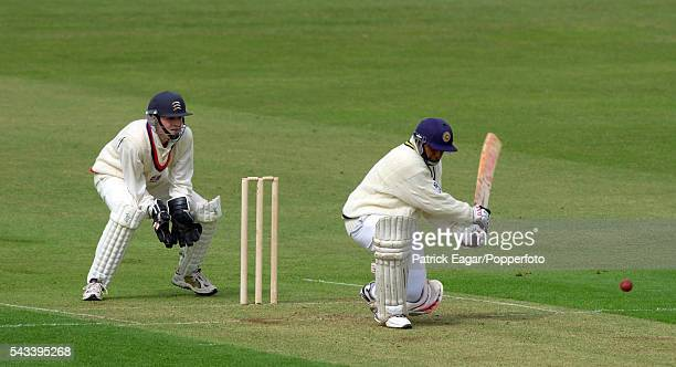 Aravinda de Silva of Sri Lanka reverse sweeps during the tour match between British Universities and the Sri Lankans at Northampton 2nd May 2002 The...
