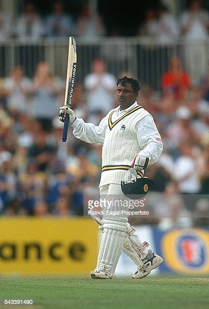 Aravinda de Silva raises his bat as he reaches his century during his innings of 152 in the only Test match between England and Sri Lanka at The Oval...