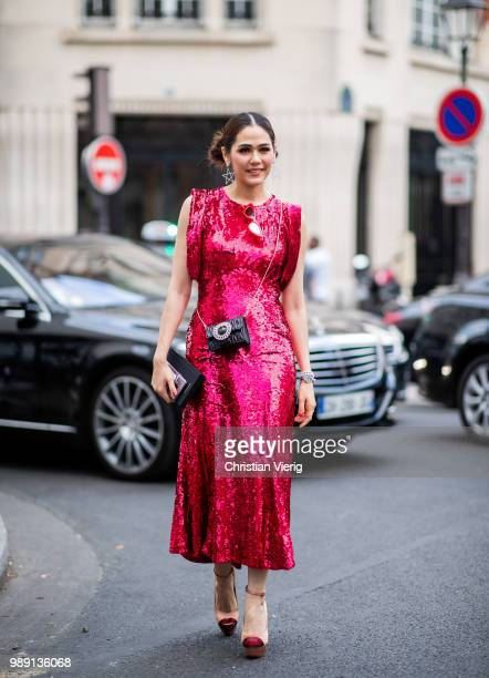 Araya Alberta Hargate wearing red dress is seen outside Givenchy during Paris Fashion Week Haute Couture FW18 on July 1 2018 in Paris France