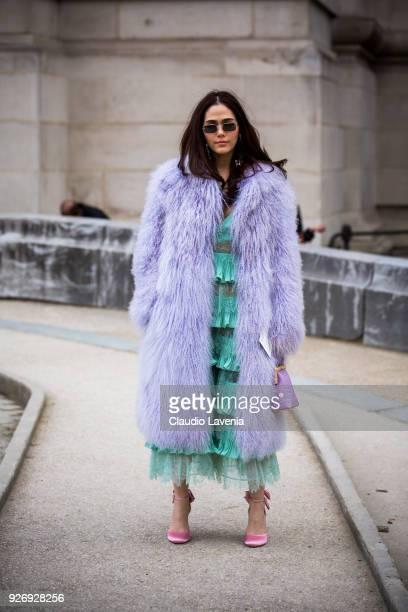 Araya Alberta Hargate wearing Saks Potts fur coat Elie Saab dress Miu Miu pink heels Perrin bag and Stella McCartney sunglasses is seen in the...