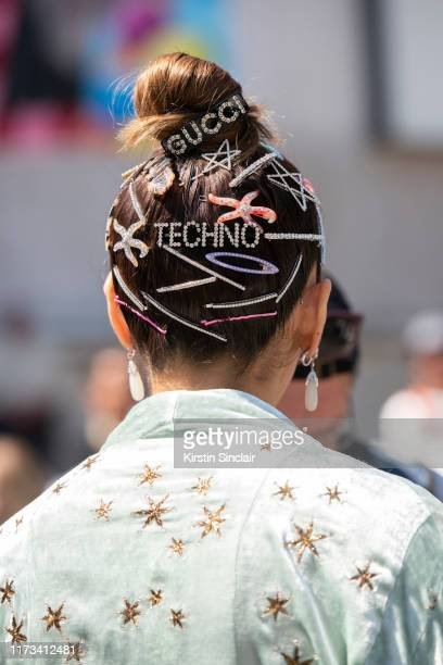 Araya Alberta Hargate wears a Gucci dress Chopard earrings and a Gucci hair clip with other hair clips on July 03 2019 in Paris France
