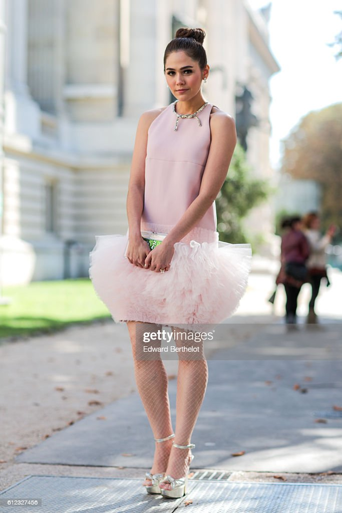 Araya Alberta Hargate wears a pink tutu dress, outside of the Giambattista Valli show during Paris Fashion Week Spring Summer 2017, at Grand Palais, on October 3, 2016 in Paris, France.