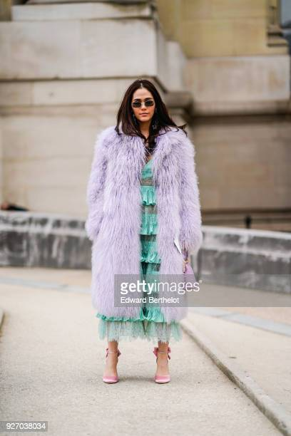 Araya Hargate wears a purple fur coat a green lace dress sunglasses during Paris Fashion Week Womenswear Fall/Winter 2018/2019 on March 3 2018 in...