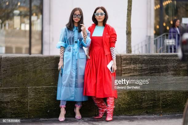 Araya Hargate wears a red jacket a red dress sunglasses outside Giambattista Valli during Paris Fashion Week Womenswear Fall/Winter 2018/2019 on...