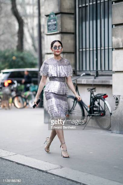 Araya Hargate wears a silver shiny glitter fringed dress outside Ralph Russo during Paris Fashion Week Haute Couture Spring Summer 2020 on January 21...