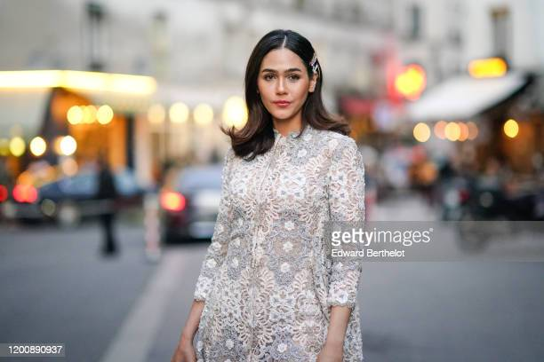Araya Hargate wears hair clips earrings a white lace dress outside Ralph Russo during Paris Fashion Week Haute Couture Spring/Summer 2020 on January...
