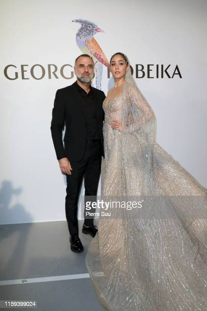 Araya Hartgate and Georges Hobeika pose backstage after the Georges Hobeika Haute Couture Fall/Winter 2019 2020 show as part of Paris Fashion Week on...