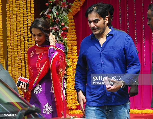 Arbaaz Khan with wife Malaika Arora Khan during Ganpati immersion ceremony at his sister Alvira's residence in Bandra on September 10 2013 in Mumbai...