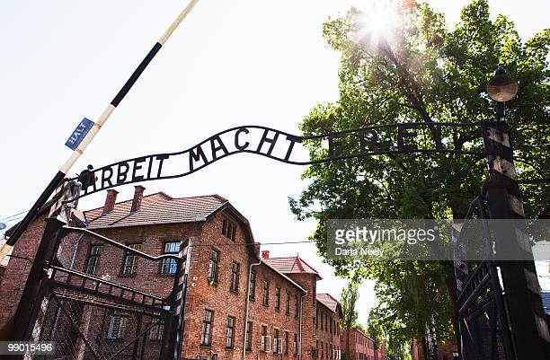 """""""arbeit macht frei"""" gate at auschwitz i - auschwitz concentration camp stock pictures, royalty-free photos & images"""
