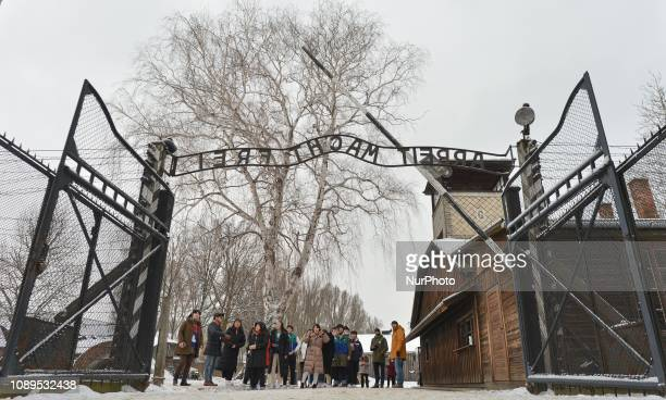 'Arbeit Macht Frei' sign over the main entrance gate to Auschwitz I on the eve of the 74th anniversary of the camp liberation by the Red Army. On...