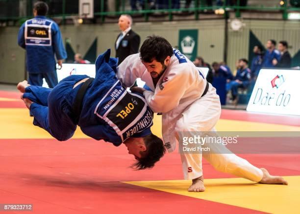 Arbi Khamkhoev of Boets Judo Club throws Rene Schneider of Kraftsportverein Esslingen JC for a wazari to win their first round contest during the...
