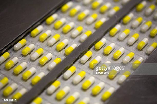 Arbidol capsules sit in sealed packets as they move along the production line at OAO Pharmstandard's Leksredstva drug manufacturing unit in Kursk...