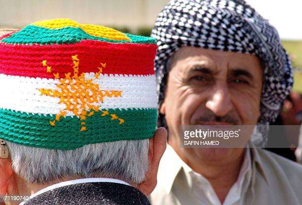 A Kurdish man wears a knitted hat with the Kurdish national flag during a memorial festival for the late Sheikh Mahmood Alhafeed in the northern...