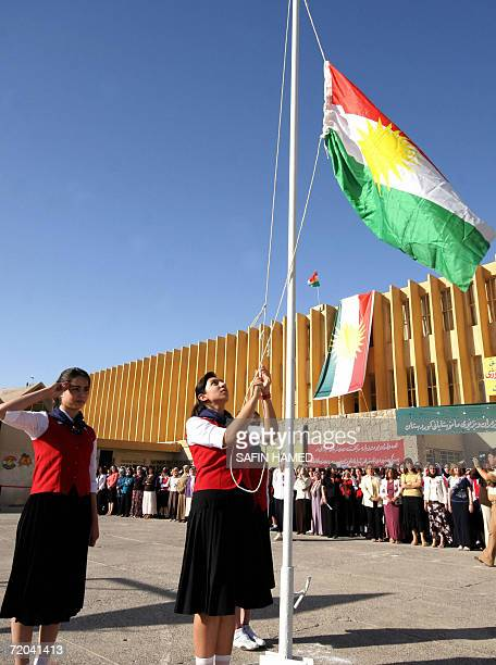 An Iraqi Kurdish girl raises the Kurdish national flag at a school in the northern city of Arbil as a new academic year starts 16 September 2006...