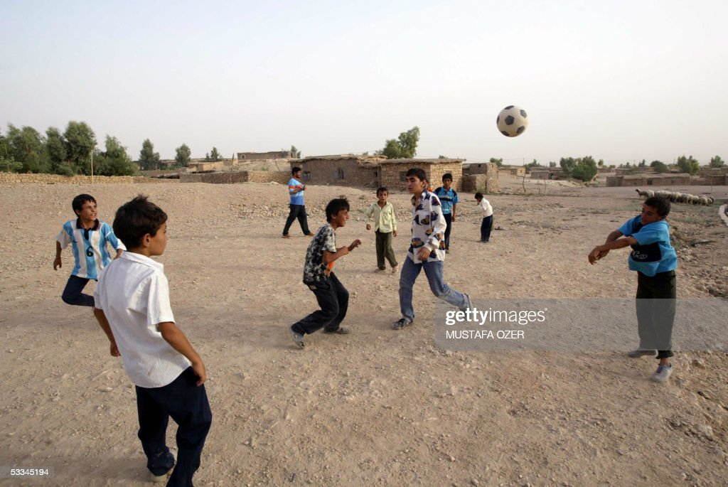 Kurdish refugee children play soccer at : News Photo