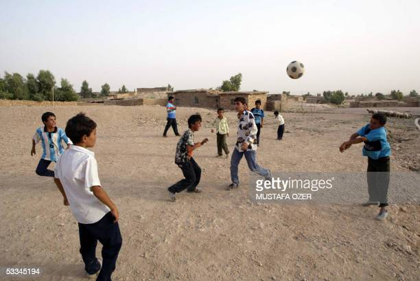 Kurdish refugee children play soccer at the Mahkmour Refugees Camp of Arbil 09 August 2005 Nearly 10 thousands refugees live at the temporary...