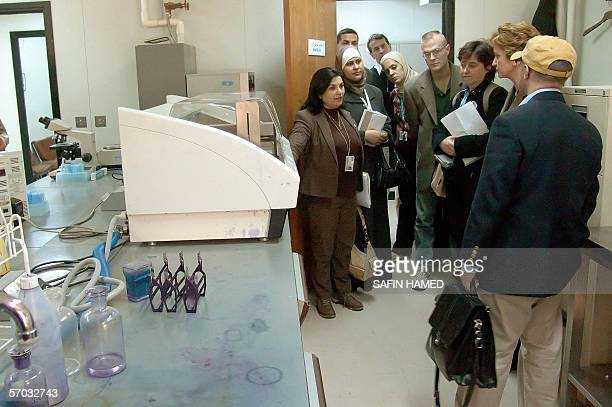 Iraq turkey hospitals stock photos and pictures getty images naeema algasser head of the world health organization delegation to iraq checks with her team a publicscrutiny Gallery