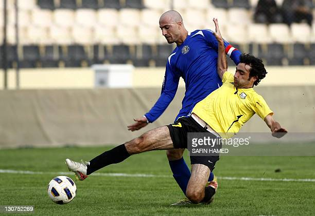 Arbil's Club's player Halgord Mulla Muhammed vies for the ball against AlTalaba Club's Majeed Hamid during the opening match of the Iraqi League...
